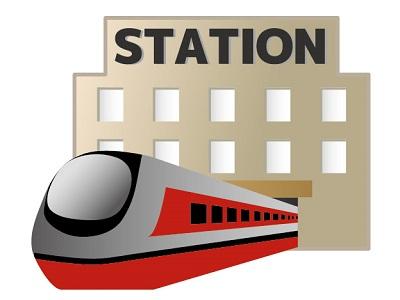駅から出発する赤い電車のイラスト